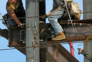 Construction workers on an I-Beam