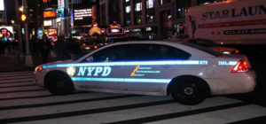 nypd car at manhattan intersection